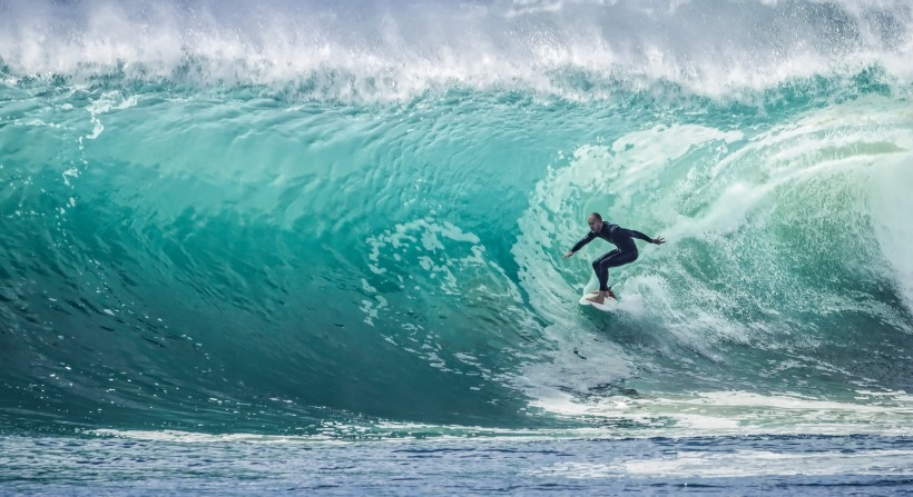 Man Surfing Large Wave In Barrel